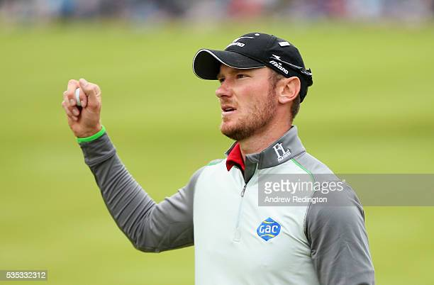 Chris Wood of England celebrates victory on the 18th green during day four of the BMW PGA Championship at Wentworth on May 29, 2016 in Virginia...