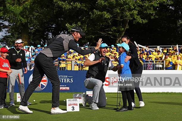 Chris Wood of England cricketer Kevin Petersen and Amena Monib celebrate a putt during the ISPS Handa Pressure Putt Showdown at The Grove on October...
