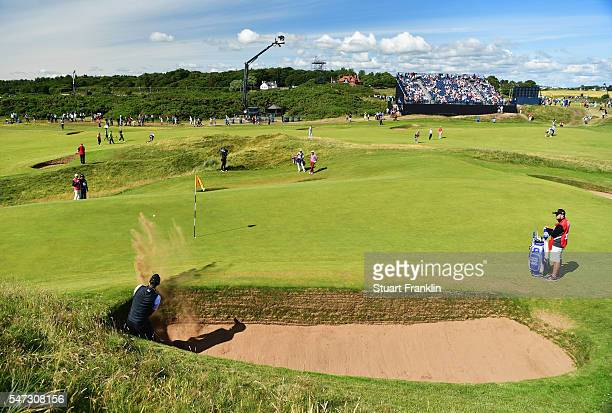 Chris Wood of England hits a bunker shot on the 8th during the first round on day one of the 145th Open Championship at Royal Troon on July 14, 2016...
