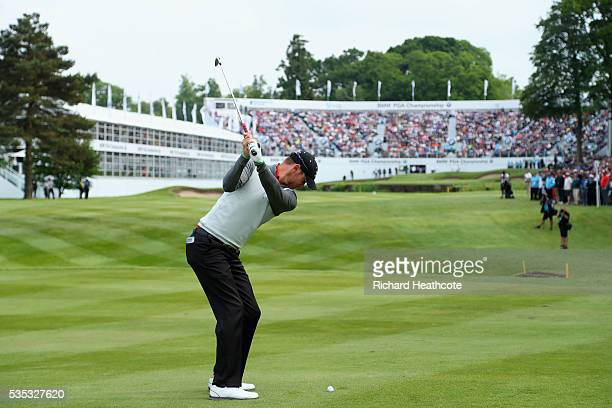 Chris Wood of England hits his 2nd shot on the 18th hole during day four of the BMW PGA Championship at Wentworth on May 29, 2016 in Virginia Water,...