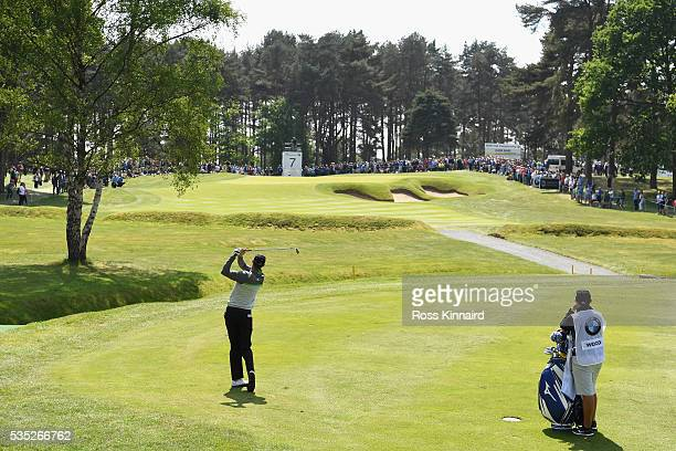 Chris Wood of England hits his 2nd shot on the 7th hole during day four of the BMW PGA Championship at Wentworth on May 29, 2016 in Virginia Water,...