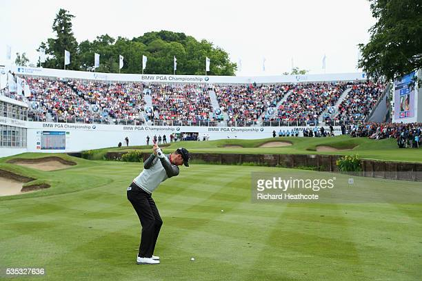 Chris Wood of England hits his 3rd shot on the 18th hole during day four of the BMW PGA Championship at Wentworth on May 29 2016 in Virginia Water...