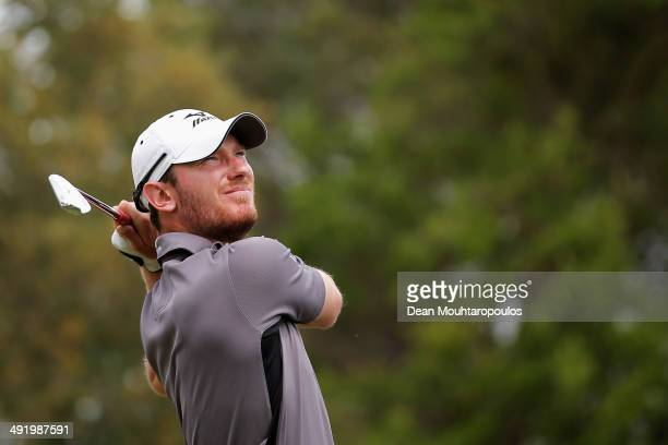 Chris Wood of England hits his second shot on the 10th hole during the final round of the Open de Espana held at PGA Catalunya Resort on May 18, 2014...