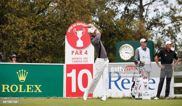 Chris Wood of England hits his tee shot on the 10th hole during the final round of the Open de Espana held at PGA Catalunya Resort on May 18, 2014 in...