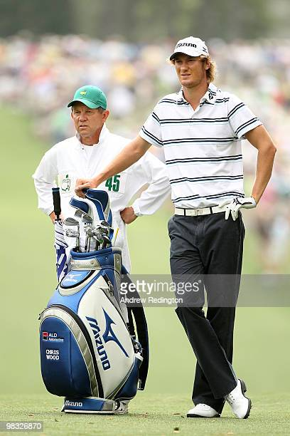 Chris Wood of England leans on his bag while alongside his caddie Dave McNeilly on the first hole fairway during the first round of the 2010 Masters...