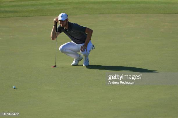 Chris Wood of England lines up a putt during round two of the Abu Dhabi HSBC Golf Championship at Abu Dhabi Golf Club on January 19 2018 in Abu Dhabi...