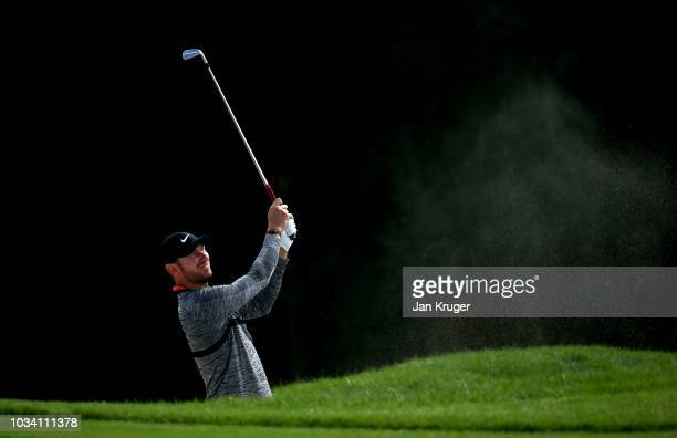 Chris Wood of England plays a shot from the bunker on the 8th hole during Day Four of the KLM Open at The Dutch on September 16, 2018 in Spijk,...
