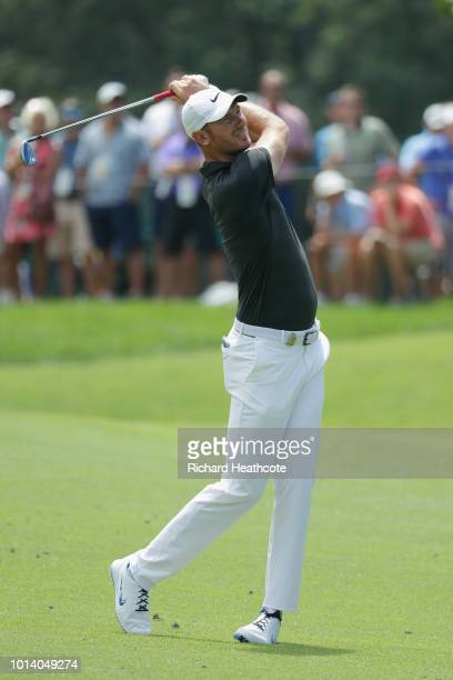 Chris Wood of England plays a shot on the first hole during the first round of the 2018 PGA Championship at Bellerive Country Club on August 9 2018...