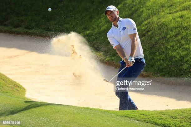 Chris Wood of England plays a shot out of a bunker on the 17th hole of his match during round one of the World Golf ChampionshipsDell Technologies...