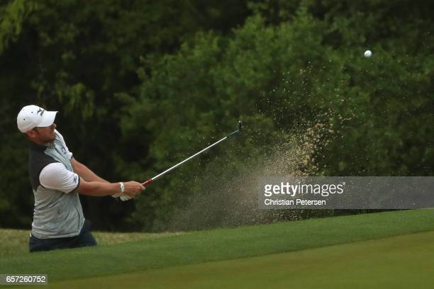 Chris Wood of England plays a shot out of a bunker on the 1st hole of his match during round three of the World Golf Championships-Dell Technologies...