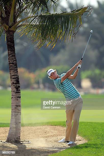 Chris Wood of England plays his second shot at the par 4, 9th hole during the third round of The Abu Dhabi Golf Championship at Abu Dhabi Golf Club...