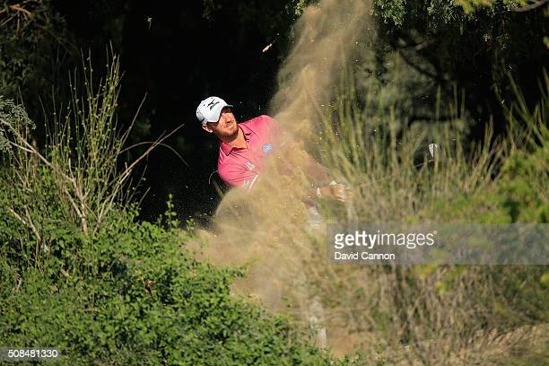 Chris Wood of England plays his second shot at the par 5, 13th hole during the second round of the 2016 Omega Dubai Desert Classic on the Majlis...