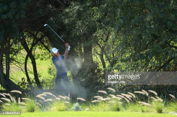 Chris Wood of England plays his second shot on the 10th hole from the trees during day two of the Commercial Bank Qatar Masters at Doha GC on March...