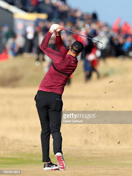 Chris Wood of England plays his second shot on the 14th hole wearing a pair of Nike golf shoes with 'Nasty' printed on the soles during the second...