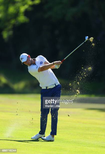 Chris Wood of England plays his second shot on the 16th hole during day two of the BMW PGA Championship at Wentworth on May 26 2017 in Virginia Water...