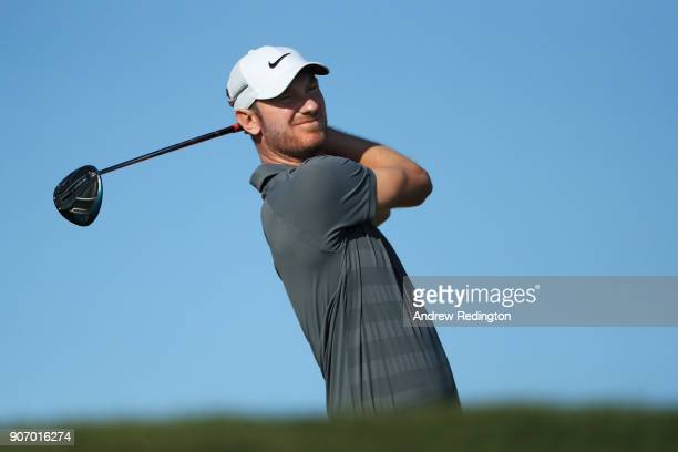 Chris Wood of England plays his shot from the third tee during round two of the Abu Dhabi HSBC Golf Championship at Abu Dhabi Golf Club on January 19...