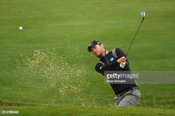 Chris Wood of England plays his third shot fom a bunker on the second hole during the third round of the British Masters at The Grove on October 15,...