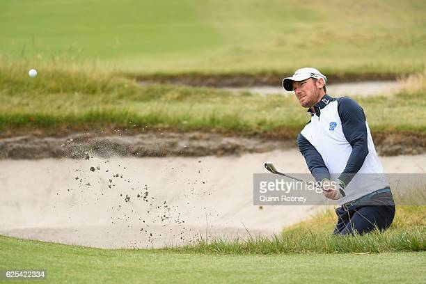 Chris Wood of England plays out of the bunker during day one of the World Cup of Golf at Kingston Heath Golf Club on November 24 2016 in Melbourne...