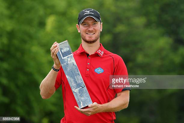 Chris Wood of England poses with the trophy following his victory during day four of the BMW PGA Championship at Wentworth on May 29, 2016 in...