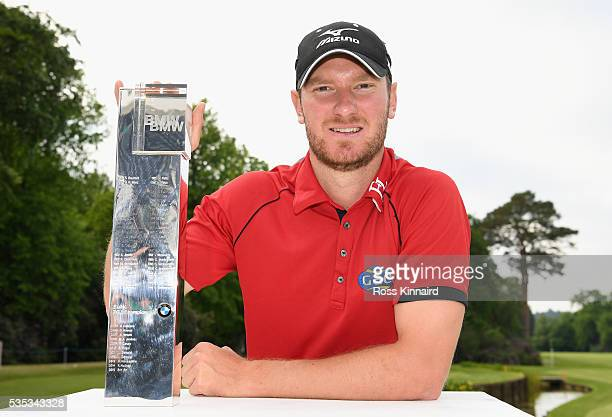 Chris Wood of England poses with the trophy following his victory during day four of the BMW PGA Championship at Wentworth on May 29 2016 in Virginia...