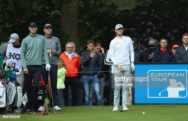Chris Wood of England Robert Karlsson of Sweden and Thomas Pieters of Belgium prepare to play their shots off the 1st tee during the second round of...