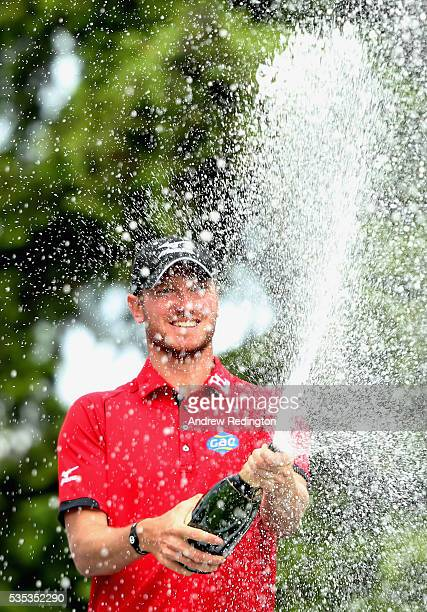 Chris Wood of England sprays champagne following his victory during day four of the BMW PGA Championship at Wentworth on May 29 2016 in Virginia...