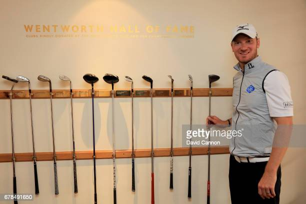 Chris Wood of England the 2016 BMW PGA Champion presenting a Mizuno 3 wood he used to the Wentworth Hall of Fame wall which is the winner's...