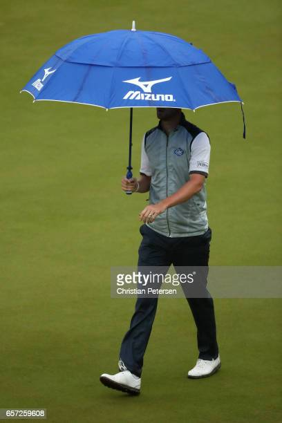 Chris Wood of England walks while rain falls on the 2nd hole of his match during round three of the World Golf Championships-Dell Technologies Match...