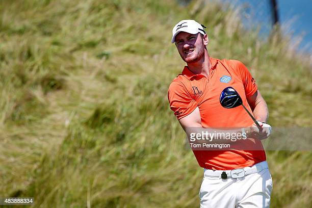 Chris Wood of England watches his tee shot on the 14th hole during the first round of the 2015 PGA Championship at Whistling Straits on August 13...