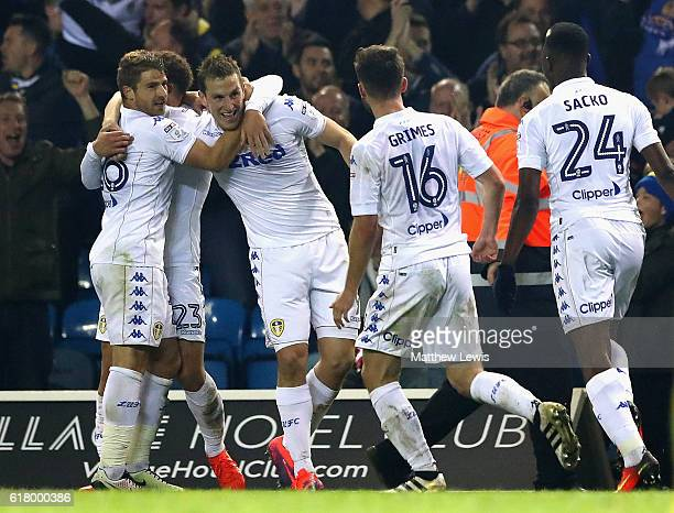 Chris Wood of Leeds United celebrates with team mates after scoring his sides second goal during the EFL Cup fourth round match between Leeds United...