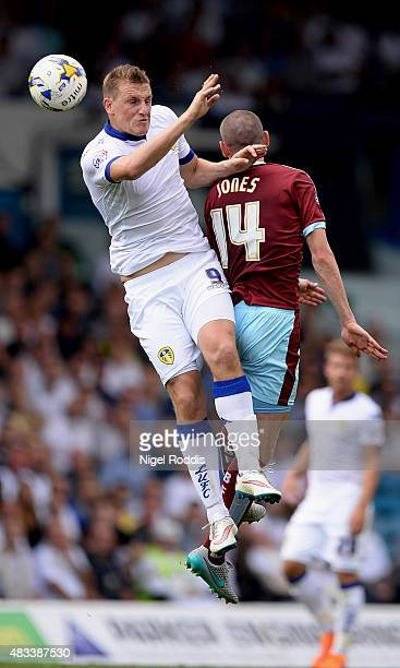 Chris Wood of Leeds United challenges David Jones of Burnley during the Sky Bet Championship match between Leeds United and Burnley at Elland Road on...