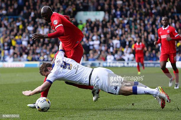 Chris Wood of Leeds United FC falls from a tackle by Alou Diarra of Charlton Athletic FC during the Sky Bet Championship match between Leeds United...