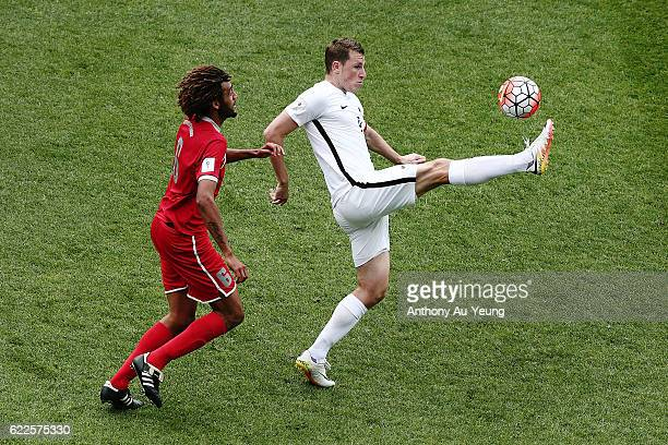Chris Wood of New Zealand controls the ball against Cedric Sansot of New Caledonia during the 2018 FIFA World Cup Qualifier match between the New...
