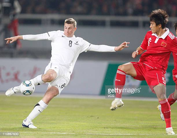Chris Wood of New Zealand fights for a ball with Du Wei of China during the international friendly match between China and New Zealand at Wuhan...