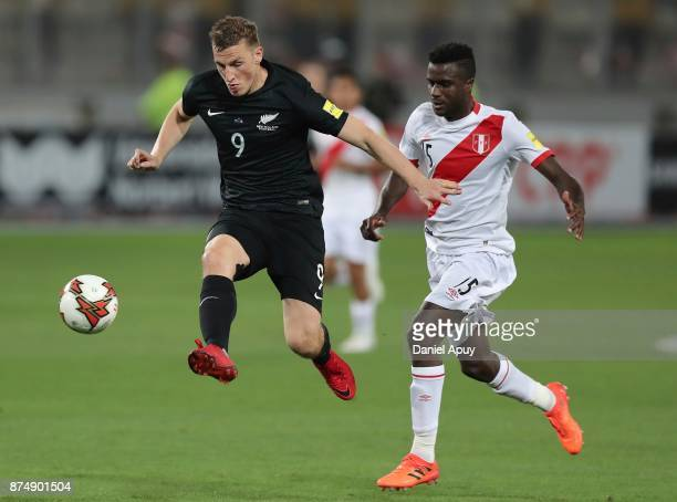 Chris Wood of New Zealand fights for the ball with Christian Ramos of Peru during a second leg match between Peru and New Zealand as part of the 2018...
