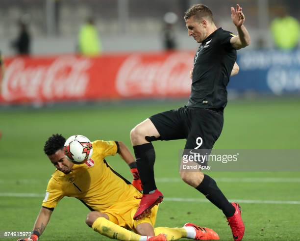 Chris Wood of New Zealand fights for the ball with Pedro Gallese goalkeeper of Peru during a second leg match between Peru and New Zealand as part of...