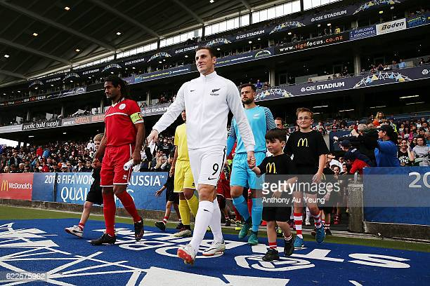 Chris Wood of New Zealand leads the team on to the pitch during the 2018 FIFA World Cup Qualifier match between the New Zealand All Whites and New...