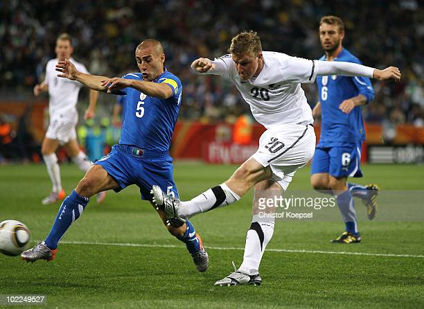 Chris Wood of New Zealand shoots as Fabio Cannavaro of Italy tries to block the shot during the 2010 FIFA World Cup South Africa Group F match...