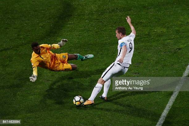 Chris Wood of New Zealand takes a shot at goal against goal keeper Phillip Mango of Solomon Islands during the 2018 FIFA World Cup Qualifier match...