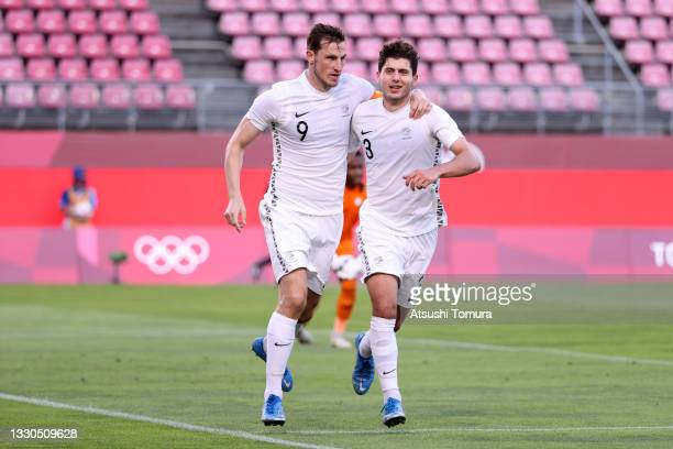 Chris Wood of Team New Zealand celebrates with teammate Liberato Cacace after scoring their side's second goal during the Men's First Round Group B...