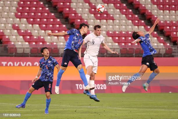 Chris Wood of Team New Zealand competes for a header with Takehiro Tomiyasu of Team Japan during the Men's Quarter Final match between Japan and New...