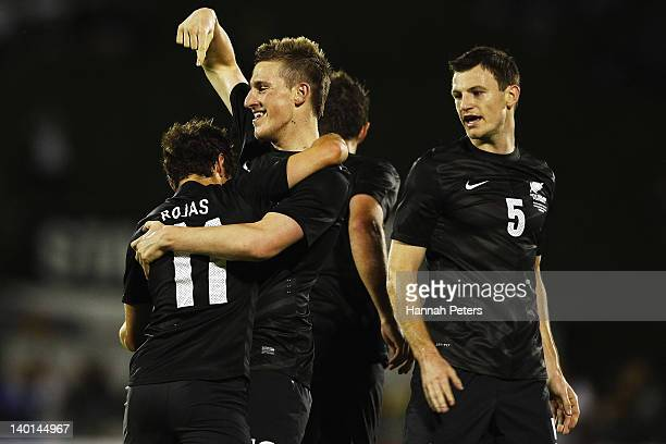 Chris Wood of the All Whites celebrates with Marco Rojas after scoring a goal during the international friendly match between the New Zealand All...