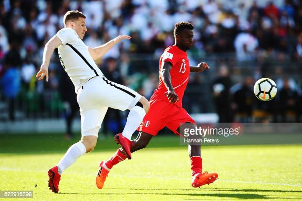 Chris Wood of the All Whites competes with Christian Ramos of Peru during the 2018 FIFA World Cup Qualifier match between the New Zealand All Whites...