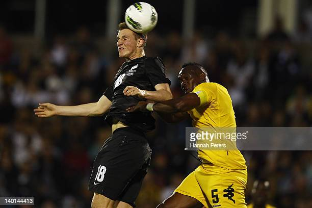 Chris Wood of the All Whites heads the ball past Claude Davis of Jamaica during the international friendly match between the New Zealand All Whites...