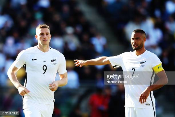Chris Wood of the All Whites is substituted on as Winston Reid of the All Whites directs his players during the 2018 FIFA World Cup Qualifier match...