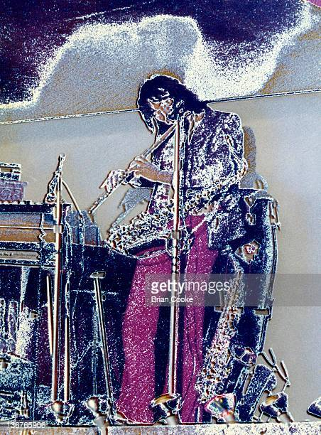 Chris Wood of Traffic performs with their psychedelic lightshow at The Kirklevington Country Club near Middlesbrough during March 1970.