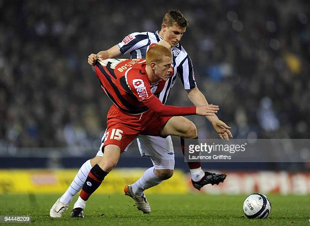 Chris Wood of West Bromwich Albion pulls the shirt of Ben Watson of QPR during the CocaCola Championship match between West Bromwich Albion and...