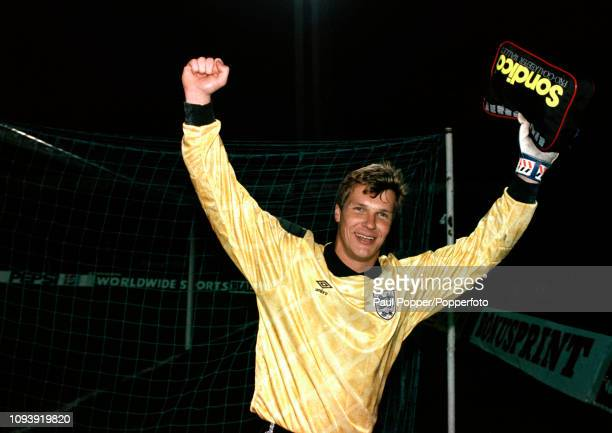 Chris Woods of England celebrates after the UEFA Euro 1992 Qualifier between Poland and England at the Stadion Miejski on November 13, 1991 in...