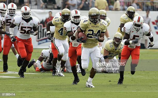 Chris Woods of the Georgia Tech Yellow Jackets runs against the Miami Hurricanes on October 2 2004 at Grant Field in Atlanta Georgia