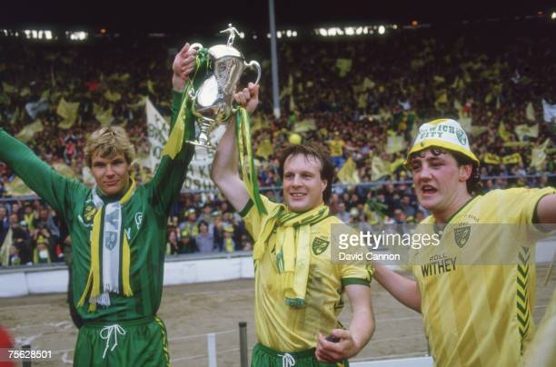 Chris Woods, Paul Haylock and Steve Bruce of Norwich celebrate beating Sunderland 1-0 in the Milk Cup Final at Wembley, March 1985.